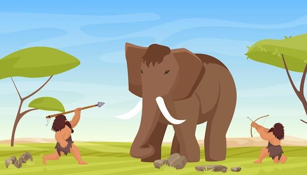 원시 원시인은 고대 털북숭이 매머드 원시 야만인 사냥꾼을 사냥합니다.