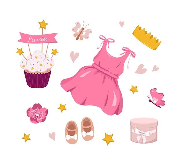 生まれたばかりの女の赤ちゃんのためのドレスクラウンカップケーキとアクセサリーの休日の装飾がセットされたプリンセス