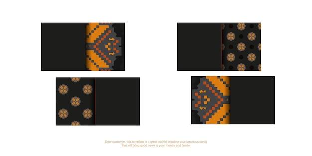 Готовый к печати дизайн черной визитки с оранжевыми славянскими узорами. шаблон визитной карточки с местом для текста и роскошными орнаментами.