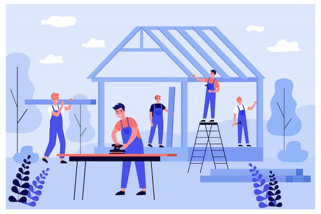 Professional carpenters team making wall and rooftop structure