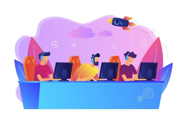 プロのゲーマーチームが、ビデオゲームをプレイするコンピューターのテーブルでヘッドセットを使用します。 eスポーツチーム、ゲーマーのグループ、プロゲーマーチームのコンセプト。