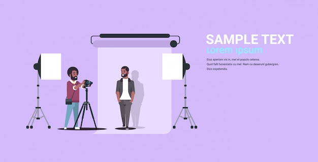 Professional photographer using camera shooting business man in formal wear   model posing in modern photo studio horizontal full length  copy space