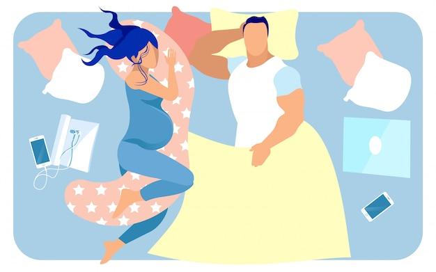 장래의 엄마와 아빠가 큰 침대에서 함께