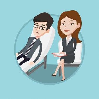 Психолог, имеющий сеанс с пациентом.