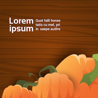 Pumpkin over wooden texture autumn banner