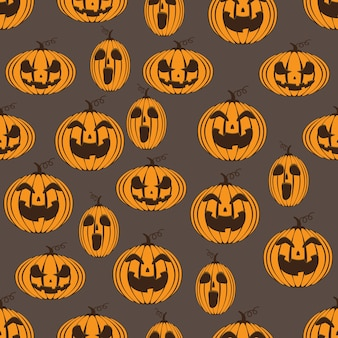 Pumpkins smile pattern seamless on grey background.
