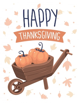 Pumpkins in wheelbarrow and text happy thanksgiving with autumn leaves on white