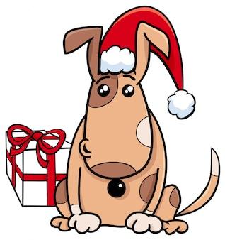 クリスマスの時間に贈り物をする子犬