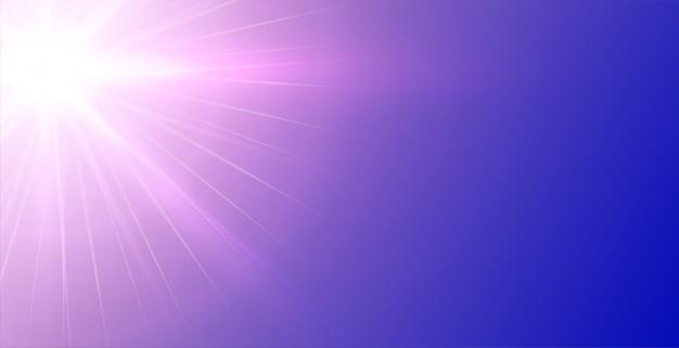 輝く光線と紫色の背景