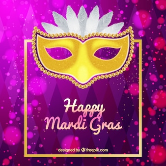 Purple bokeh background with golden carnival mask
