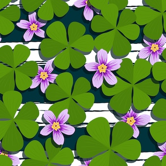 Purple flower and green clover seamless pattern