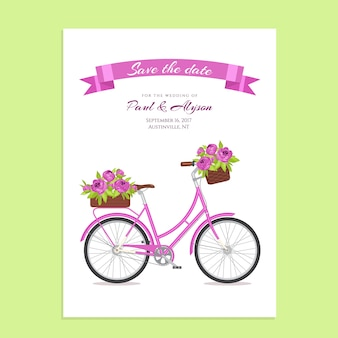 Purple retro bicycle with bouquet in floral basket and box on trunk.