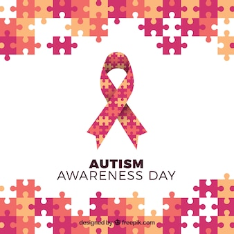 Puzzle background with autism day ribbon