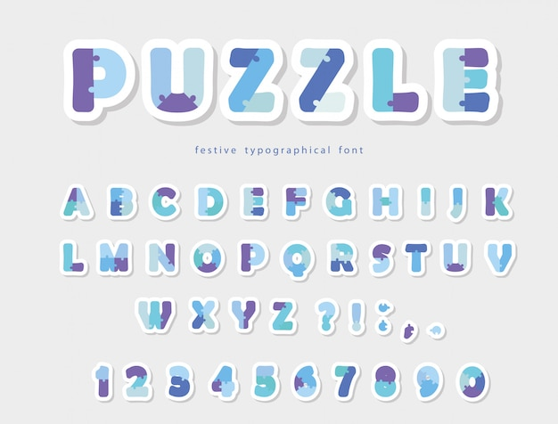 Puzzle paper cut out font in blue colors.