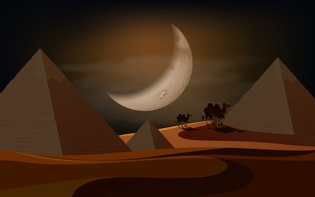 Pyramid desert scene at night