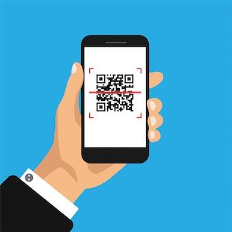 手は、画面上のqrコードで携帯電話を保持しています。
