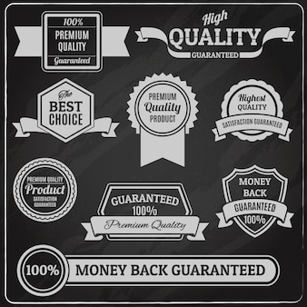 Quality labels and badges set on chalkboard