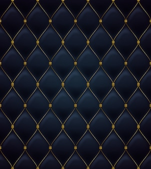 キルトのシームレスなパターン。黒色。繊維に金色の金属ステッチ。