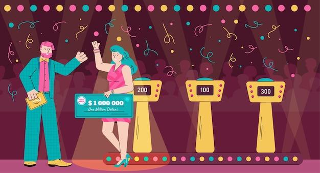 Ведущий и победитель игрового шоу-викторины держит денежный приз