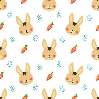 ウサギとニンジンの動物のベクトルのシームレスなパターンの背景