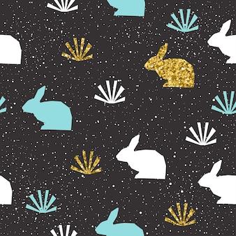 ウサギの背景。カード、招待状、アルバム、スクラップブック、イースターホリデー包装紙、織物、衣服などの金、青、白の抽象的なウサギ。家畜のテーマ。ゴールドの質感。