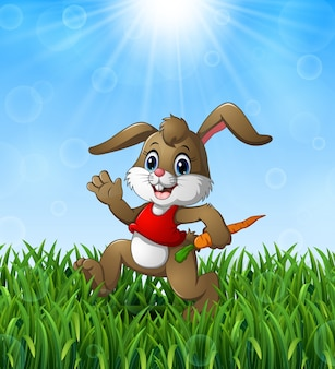 Rabbit cartoon holding a carrot in the grass on a background of bright sunshine