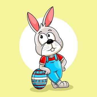 イースターの日のイラストの大きな卵でポーズをとるウサギの漫画