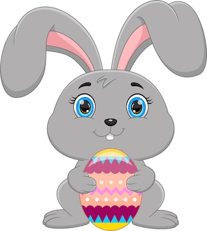 Rabbit with easter egg on white background