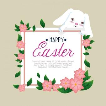 Кролик со счастливой пасхальной открыткой и цветами
