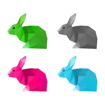 白い背景に分離された架空の色で描かれたウサギのセット。デザインで使用するための抽象的な明るい多角形の幾何学的な三角形のイラスト。