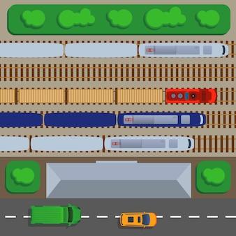Vista dall'alto della ferrovia con treni e rotaie, piattaforma e illustrazione del deposito.