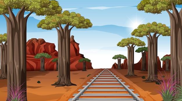 昼間の砂漠の風景シーンを通る鉄道
