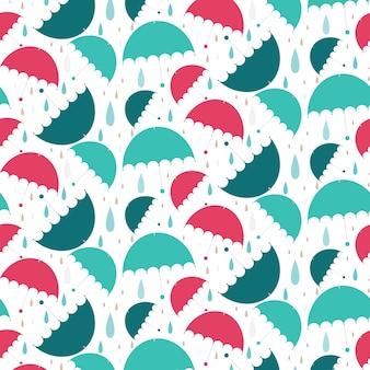 雨と明るい傘のシームレスなパターン。ベクトル図背景。