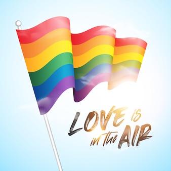 レインボーフラッグlgbtmovement、白い背景に手を振るゲイプライドの旗、クローズアップ、愛を込めて孤立したテキストが空中にあります