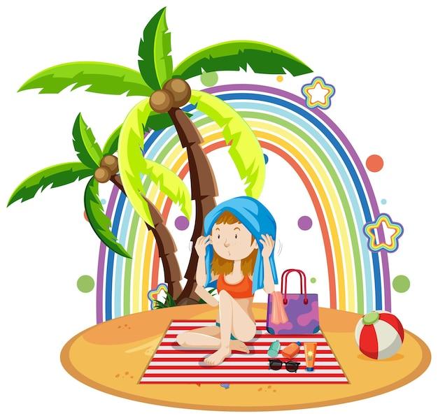 Arcobaleno sull'isola con una ragazza sulla spiaggia