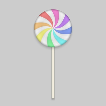 Rainbow lolipop candy on white