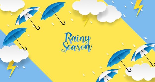 梅雨。雨のしずく、傘、青の背景に雲のデザイン。ベクター。