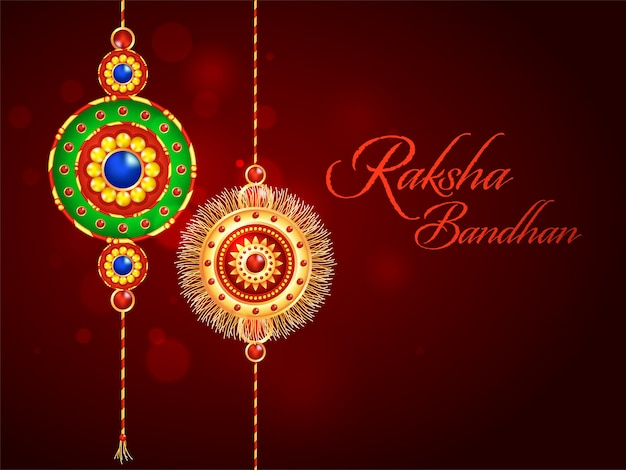 Raksha bandhan font with decorative rakhis (wristband) on dark red blur bokeh background.