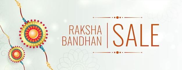 Raksha bandhan white sale banner with realistic rakhi