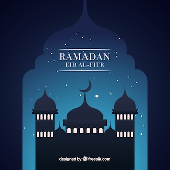 Ramadan background with mosque silhouette at night