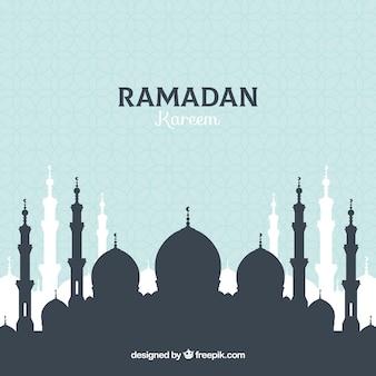フラットスタイルのモスクシルエットのラマダンの背景