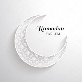 Ramadan kareem card with white ornamental moon with shadow and the black inscription ramadan kareem on a light background.