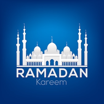 Ramadan kareem greeting card with white silhouette of a mosque on a dark blue background.