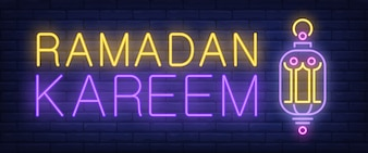 Ramadan Kareem neon sign. Glowing bar lettering and lamp