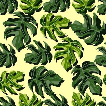 ランダムな明るい植物のシームレスなモンステラパターン。エキゾチックな緑の葉は明るい黄色の背景に。壁紙、テキスタイル、包装紙、布プリントに最適です。図。