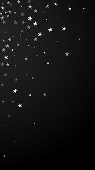 임의의 떨어지는 별 크리스마스 배경입니다. 검은 배경에 미묘한 비행 눈 조각과 별. 사랑스러운 겨울 은색 눈송이 오버레이 템플릿입니다. 뽀얀 세로 그림.