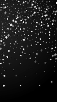 Random falling stars christmas background. subtle flying snow flakes and stars on black background. amazing winter silver snowflake overlay template. exquisite vertical illustration.