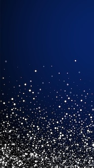 Random white dots christmas background. subtle flying snow flakes and stars on dark blue background. appealing winter silver snowflake overlay template. overwhelming vertical illustration.