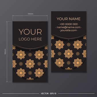 Ready to print business card design with greek patterns. business card set in black with vintage ornaments.