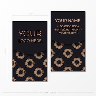 고급스러운 패턴으로 바로 인쇄 가능한 명함 디자인입니다. 빈티지 장식품으로 장식된 검은색 명함입니다.